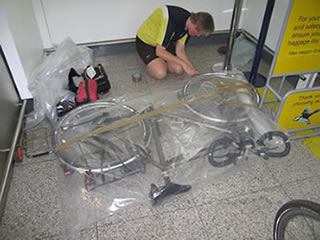 Frank adding the last bits of tape to securimagee the bike bags